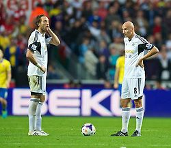 28.09.2013, Liberty Stadion, Swansea, ENG, Premier League, Swansea City vs FC Arsenal, 6. Runde, im Bild Swansea City's Miguel Perez Cuesta 'Michu' and Jonjo Shelvey look dejected as Arsenal score the opening goal during the English Premier League 6th round match between Swansea City AFC and Arsenal FC at the Liberty Stadium, Swansea, Great Britain on 2013/09/28. EXPA Pictures © 2013, PhotoCredit: EXPA/ Propagandaphoto/ David Rawcliffe<br /> <br /> ***** ATTENTION - OUT OF ENG, GBR, UK *****