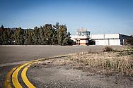 Pisticci Scalo, Basilicata, Italia 27/01/2016 <br /> La torre di controllo dell'aviosuperficie &quot;E.Mattei&quot;. <br /> Indicata anche come aviosuperficie di Basilicata, si trova a Pisticci Scalo, in provincia di Matera.<br /> <br /> La struttura venne realizzata negli anni '60, durante l'industrializzazione della val Basento, su iniziativa di Enrico Mattei, per una sua personale maggiore rapidit&agrave; di spostamento tra i siti ENI.<br /> <br /> Inutilizzata per molto tempo. Il 22 maggio 2014 &egrave; stata affidata dal CSI (consorzio per lo sviluppo industriale) di Matera la gestione della stessa aviosuperficie alla societ&agrave; aerotaxi Winfly, che ha sede all'Aeroporto di Pontecagnano, vicino Salerno.<br /> <br /> Al momento, la struttura consente l'atterraggio a velivoli con una capienza massima di nove posti.<br /> <br /> Pisticci Scalo, Basilicata, Italy, 27/01/2016<br /> The control tower of the airstrip &quot;E. Mattei&quot;.<br /> Also named as &quot;Airfield of Basilicata&quot;, it is located in Pisticci Scalo, near Matera.<br /> <br /> The structure, a simple airstrip, was built in the 60s, during the industrialization of the Basento valley, on the initiative of Enrico Mattei, for a faster personal transfer between ENI company sites.<br /> <br /> Unused for a long time. On the 22nd May 2014 the CSI (Consortium for Industrial Development) of Matera entrusted the management of the airfield to the air taxi Winfly company, based in the Airport of Pontecagnano near Salerno.<br /> <br /> At the moment, the structure allows the landing to airplanes with a maximum capacity of nine seats.