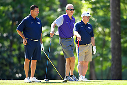 John Congemi, Steve Fuller and Pat Narduzzi wait to tee off during the Chick-fil-A Peach Bowl Challenge at the Oconee Golf Course at Reynolds Plantation, Sunday, May 1, 2018, in Greensboro, Georgia. (Dale Zanine via Abell Images for Chick-fil-A Peach Bowl Challenge)