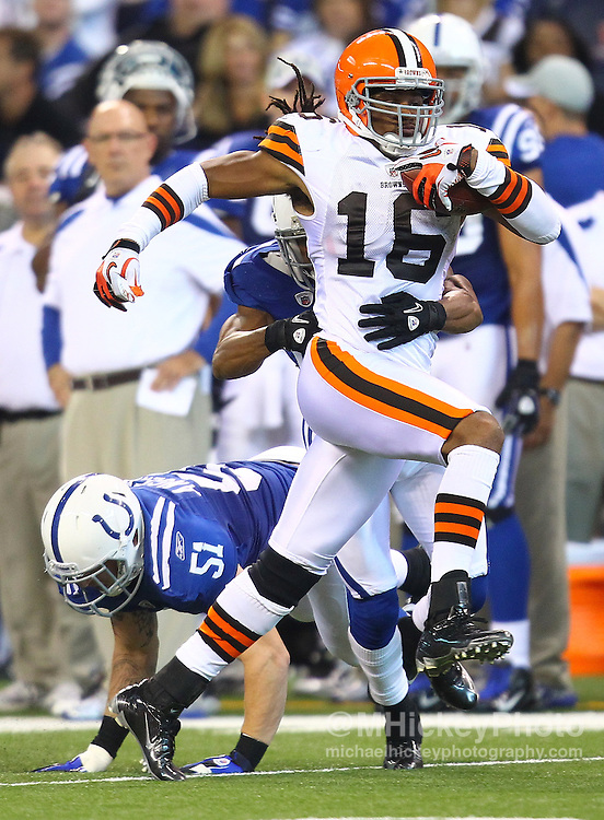 Sept. 18, 2011; Indianapolis, IN, USA; Cleveland Browns wide receiver Josh Cribbs (16) runs the ball after a reception as Indianapolis Colts cornerback Justin Tryon (20) tackles from behind at Lucas Oil Stadium.  Mandatory credit: Michael Hickey-US PRESSWIRE