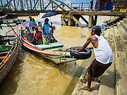 22 OCTOBER 2015 - YANGON, MYANMAR:    A worker brings a cross river ferry into the pier on the Yangon side of the Yangon river. The ferries, which charge passengers a few cents per trip, are an important part of the Yangon transportation system.  PHOTO BY JACK KURTZ