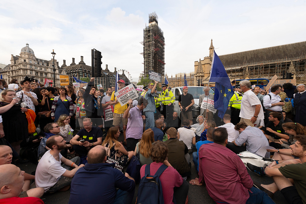 © Licensed to London News Pictures. 28/08/2019. London, UK.  Protesters take part in a demonstration in Westminster against British Prime Minister Boris Johnson's plan to suspend Parliament until October 14th. Opponents of the Prime Minister suggest the move is to reduce the time available for MP's  to stop a no deal Brexit. Photo credit: Ray Tang/LNP