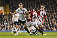 Harry Kane of Tottenham Hotspur gets away from the challenge of Michael Doyle of Sheffield United during the Capital One Cup Semi-Final 1st Leg match between Tottenham Hotspur and Sheffield Utd at White Hart Lane, London, England on 21 January 2015. Photo by David Horn.