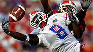 University of Florida player #8 Chad Jackson just misses a pass as University of Georgia player #23 Tim Jennings breaks it up during the first half of the game at Alltel Stadium in Jacksonville, FL on October 30, 2004. The Georgia Bulldogs beat the Florida Gators 31-24.
