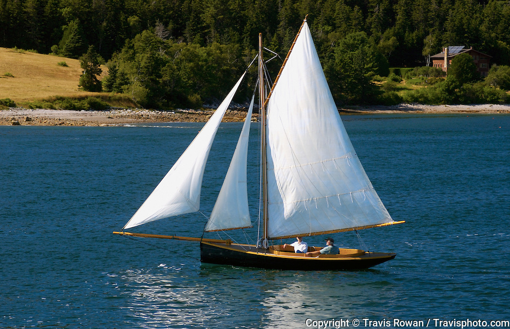 A sailboat cruising out of Some Sound, Maine.