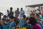 People enjoy a few drinks at one of multiple beachside bars at Labadi Beach in Accra, Ghana on Sunday October 8, 2007. Also known as La Pleasure Beach, it is one of the city's most popular hangouts, especially on Sunday afternoons.