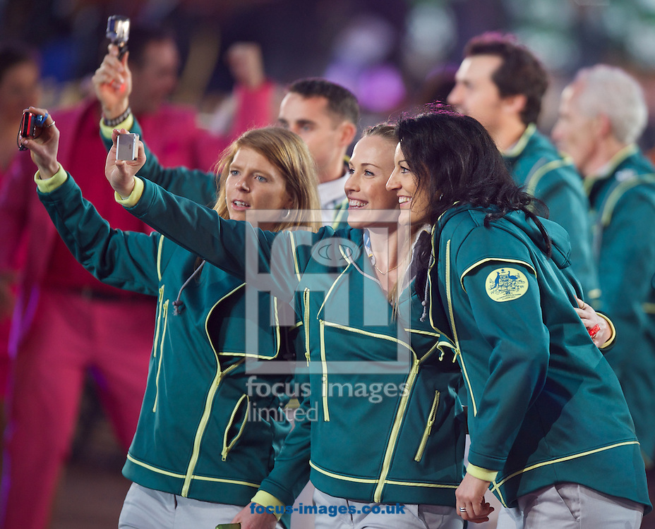 Australian team members taking selfies during the Glasgow 2014 Commonwealth Games Opening Ceremony at Celtic Park, Glasgow<br /> Picture by Alan Stanford/Focus Images Ltd +44 7915 056117<br /> 23/07/201