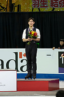 KELOWNA, BC - OCTOBER 27: Mens long program bronze medalist, Japanese skater Keiji Tanaka stands on the podium at Prospera Place on October 27, 2019 in Kelowna, Canada. (Photo by Marissa Baecker/Shoot the Breeze)