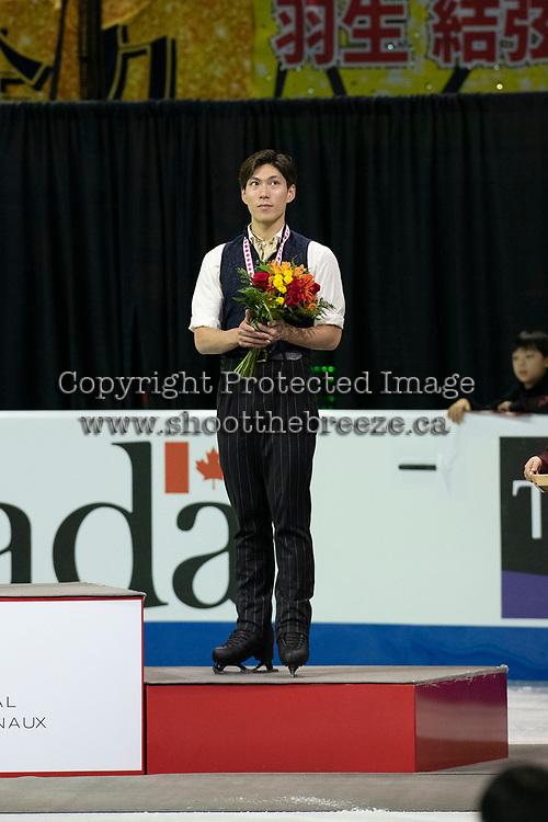 KELOWNA, BC - OCTOBER 27: Mens long program bronze medalist, Japanese skater Keiji Tanaka stands on the podium at Prospera Place on October 27, 2019 in Kelowna, Canada. (Photo by Marissa Baecker/Shoot the Breeze)