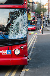 © Licensed to London News Pictures. 25/11/2013. London, UK. The accident scene where a bus collided with a pedestrian at rush hour this morning in Farringdon, central London. The smashed bus window shows the point of impact.  Photo credit : Richard Isaac/LNP