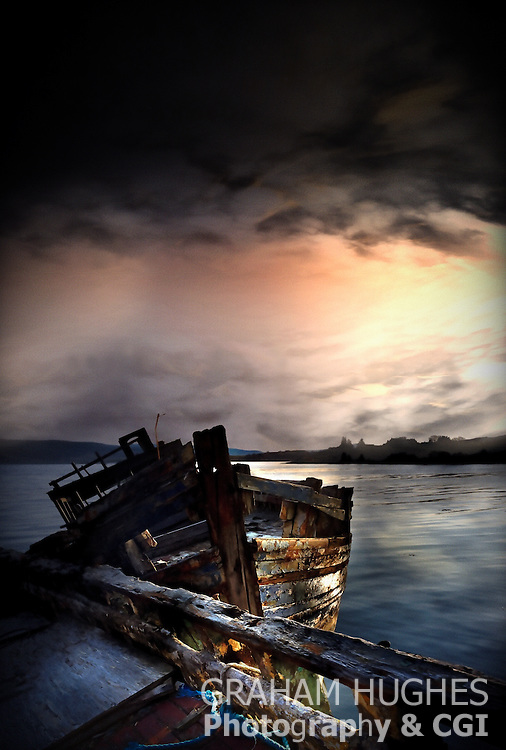 Rotting wooden boat at shoreline at Salen, Isle of Mull, Scotland