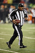 NFL field judge Buddy Horton (82) runs with the ball during the Cincinnati Bengals NFL AFC Wild Card playoff football game against the Pittsburgh Steelers on Saturday, Jan. 9, 2016 in Cincinnati. The Steelers won the game 18-16. (©Paul Anthony Spinelli)