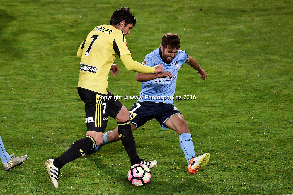 Gui Finkler of the Phoenix (L) is tackled by Sydney's Michael Zullo during the A-League - Phoenix v Sydney FC  football match at Westpac Stadium in Wellington on Sunday the 23rd October 2016. Copyright Photo by Marty Melville / www.Photosport.nz