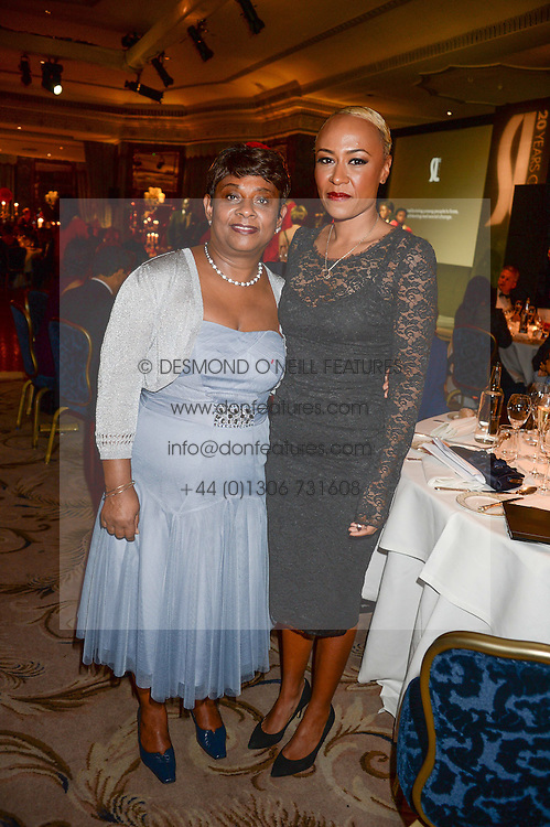 Left to right, BARONESS LAWRENCE OF CLARENDON and EMELI SANDE at the inaugural Stephen Lawrence Memorial Ball held at The Dorchester, Park Lane, London on 17th October 2013.