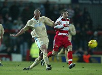 Photo: Aidan Ellis.<br /> Doncaster Rovers v Bristol City. Coca Cola League 1.<br /> 26/11/2005.<br /> Bristol's Mat Heywood clears from Doncaster's Nick Fenton