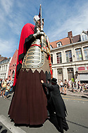 Les Fêtes de Gayant (Gayant Festival), Douai, Nord-Pas de Calais, France. Les Fêtes de Gayant is an annual festival taking place in July, which dates back to the 1530s and centres around a ritual procession with huge wicker figures (Gayant, the largest of this 'giant' family; his wife and three children), along with a carnival-like parade with a variety of other participants, music and floats. Les Fêtes de Gayant in Douai is inscribed on the UNESCO list of Intangible Cultural Heritage, along with several other traditional processions with huge effigies of giants or dragons in France and Belgium. © Rudolf Abraham