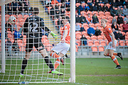 Brad Potts (Blackpool) watches as the ball drops inside the far post from Kyle Vassell's (Blackpool) unorthodox shot. Joe Fryer (Hartlepool United) is left stranded as Blackpool score the winning goal. 2-1 to the home team during the EFL Sky Bet League 2 match between Blackpool and Hartlepool United at Bloomfield Road, Blackpool, England on 25 March 2017. Photo by Mark P Doherty.