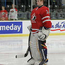 COBOURG, - Dec 16, 2015 -  Game #9 - Canada East vs Canada West at the 2015 World Junior A Challenge at the Cobourg Community Centre, ON. Matthew Murray #31 of Team Canada West during the national anthem<br /> (Photo: Amy Deroche / OJHL Images)