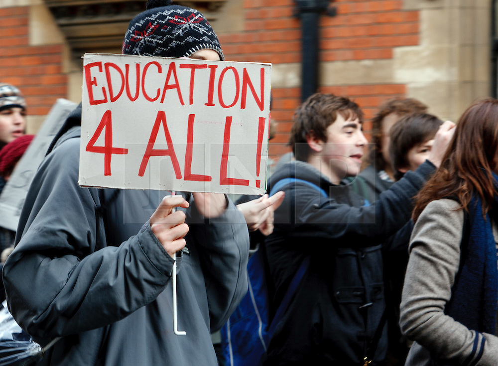 """©under licence to London News Pictures. 30/11/2010.  Student protesting against increased tuition Fees display banner with """"Education 4 All!"""" at Cambridge University today (30/11/2010). Photo credit should read Jason Patel/London News Pictures"""