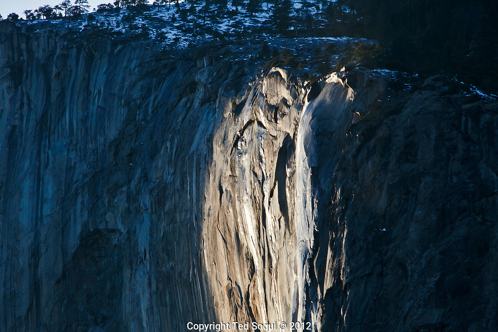 Winter scenes in Yosemite Valley located in the Yosemite National Park..Late afternoon view of Horse Tail Fall located on El Capitan. This fall generally flows only in late February to early March. It also produces a fire fall color effect from the sunset for three weeks in February.