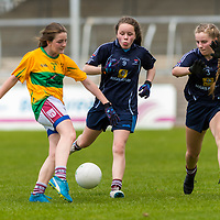 Ella Courtney takes a shot past Kiah Kenneally and Victoria Burns.<br /> <br /> Division 1 between Barefield NS and Knockanean NS in the Clare Primary Schools Ladies Football Finals at Cusack Park, Ennis, Co. Clare