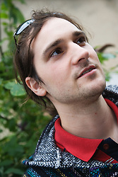 Portrait of young Czech man looking upwards,