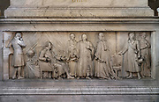 Bas-relief of Malesherbes defending Louis XVI, designed by Francois Joseph Bosio, 1768-1845, and sculpted by Jean-Pierre Cortot, 1787-1843, on the plinth of the statue of Guillaume-Chretien de Lamoignon de Malesherbes, 1721-94, 1826, by Jacques Edmee Dumont, 1761-1844, in the Salle des Pas Perdus, or Hall of Lost Causes, an enormous vestibule leading to the courthouses, in the Palais de Justice or Paris Law Courts, on the Ile de la Cite, Paris, France. The former royal palace was originally a medieval building, reworked and rebuilt several times, with a major reconstruction 1857-68 by architects Joseph-Louis Duc and Honore Daumet under Haussmann. The complex includes the Palais de Justice, the Sainte-Chapelle and the Conciergerie. Picture by Manuel Cohen