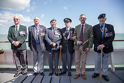 @Licensed to London News Pictures 21/05/15. Dover, Kent. Veterans (L-R) Major Stephen Taylor (97), Staff Sargeant Nicholas Taylor, Wing Commander Philip Pring, Warrant Officer Arthur Taylor (94) RAF, Major Stuart Taylor RM and Cpl Donald Watkins commemorate the 75th anniversary of Operation Dynamo today aboard DFDS Ferries crossing to Dunkirk in France. Operation Dynamo was the name given to the planned evacuation of Allied troops from the beaches of Dunkirk in 1940 during WWII.Photo credit: Manu Palomeque/LNP