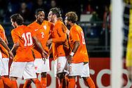 12-11-2015 VOETBAL:JONG ORANJE-JONG WIT RUSLAND:TILBURG<br /> Koning Willem II Stadion EK-kwalificatiewedstrijd<br /> <br /> Jong oranje speler Joshua Brenet (PSV) viert het doelpunt van Jong oranje speler Vincent Janssen (AZ) en viert dit met Jong oranje speler Joris van Overeem (AZ)e n Jong oranje speler Tony Vilhena (Feyenoord) <br /> <br /> Foto: Geert van Erven