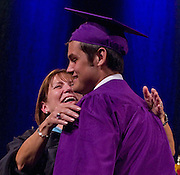 Photo by Phil Grout..It was a joyous moment for Loch Raven High School principal Bonnie Lambert and graduate Matt Gill just after he received his diploma.