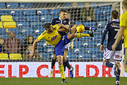 Birmingham City forward Lukas Jutkiewicz (10) battles with Millwall defender Shaun Hutchinson (4) during the EFL Sky Bet Championship match between Millwall and Birmingham City at The Den, London, England on 28 November 2018.