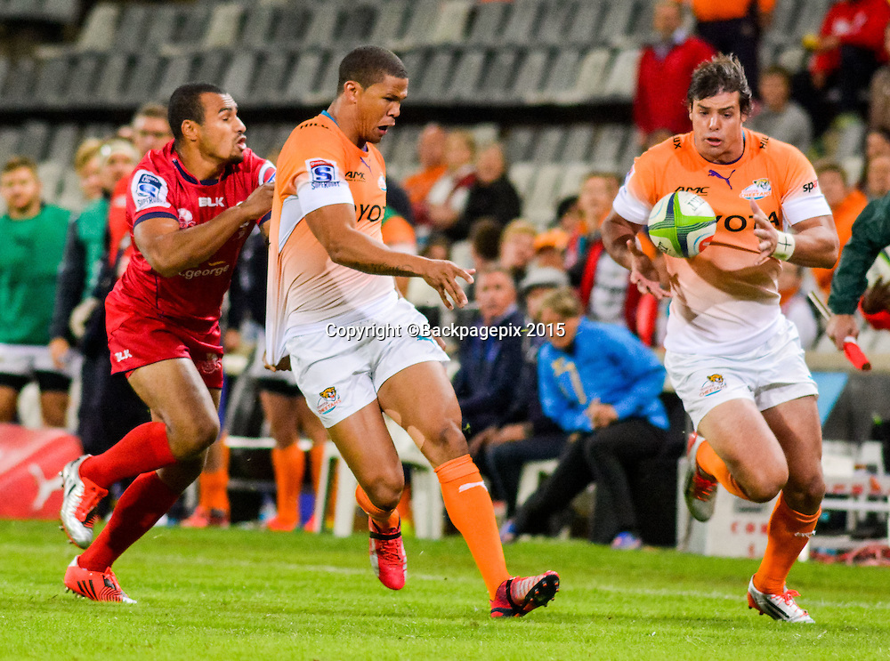 Ryno Benjamin and Francois Venter of Free State Cheetahs and Will Genia of the Reds during the Super 15 match between Free State Cheetahs and Reds on 18 April 2015 at Free State Stadium<br />  &copy;Frikkie Kapp/BackpagePix