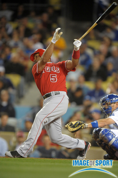 Apr 3, 2012; Los Angeles, CA, USA; Los Angeles Angels first baseman Albert Pujols (5) bats during the game against the Los Angeles Dodgers at Dodger Stadium.