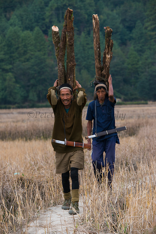 Apatani man carrying wood<br /> Apatani Tribe<br /> Ziro Valley, Lower Subansiri District, Arunachal Pradesh<br /> North East India