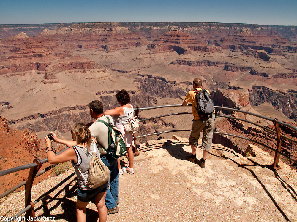 15 AUGUST 2009 -- GRAND CANYON NATIONAL PARK:  Tourists look out into the Grand Canyon from Mohave Point on the south rim of Grand Canyon National Park.  PHOTO BY JACK KURTZ