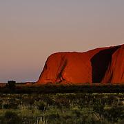 Uluru in the morning, at sunrise. Uluru (Ayers Rock or Red Rock) in Northern Territory. World Heritage Site, Uluru-Kata Tjuta National Parl is sacred to the Anangu, the Arboriginal People of the area.