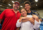 Jesse Garcia hugs his mother after signing with Ecclesia College during Athletic Signing Day at the Pavilion, February 1, 2017.