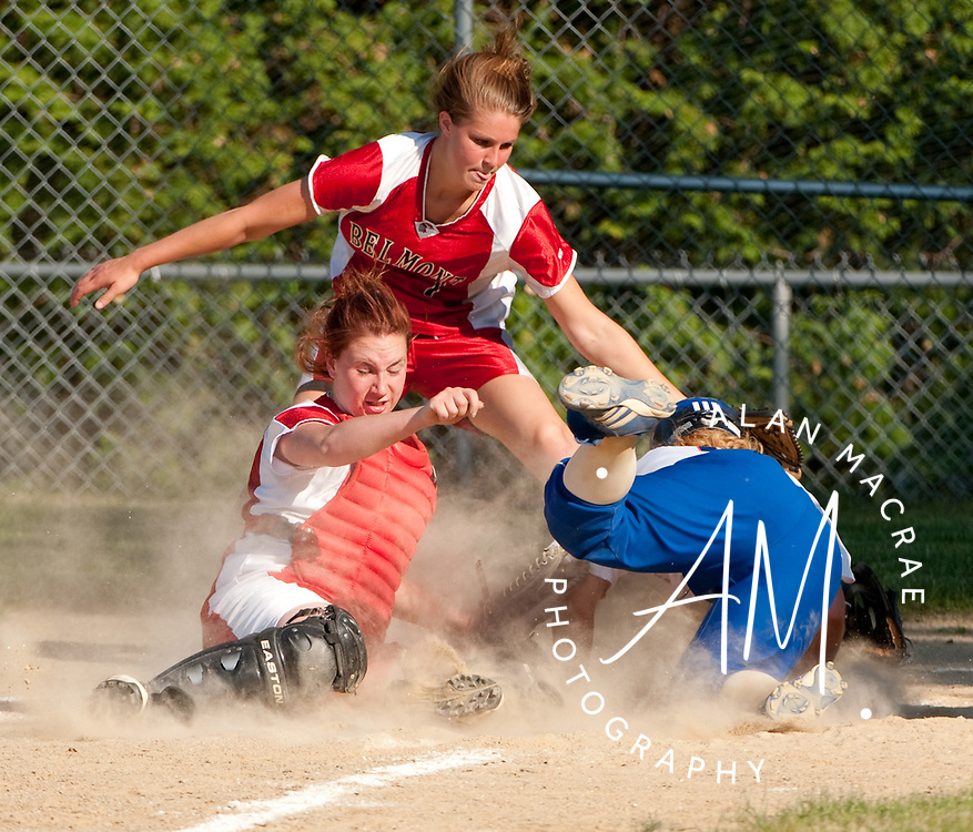 Inter Lakes Kaleigh Richardson slides safely into home as Belmont catcher S. Talbot [6] and pitcher C. Cooper [2] try for the out during Wednesday's game at Belmont.  (Alan MacRae/for the Citizen)