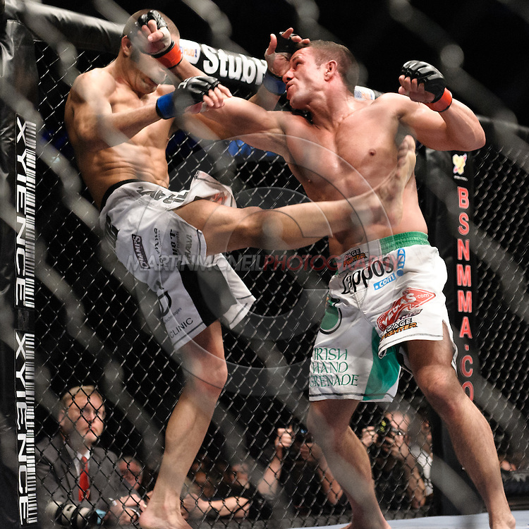 """LONDON, ENGLAND, JUNE 7, 2008: Mike Swick (left) and Marcus Davis trade blows during """"UFC 85: Bedlam"""" inside the O2 Arena in Greenwich, London on June 7, 2008."""