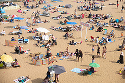 © Licensed to London News Pictures. 04/08/2018. London, UK. Large numbers of people are seen on Broadstairs beach in East Kent during hot weather. Photo credit: Ray Tang/LNP