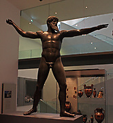 Bronze statue (modern replica) Found in the sea off Cape Artemisium, Euboea, Greece in 1928.  Zeus or an elderly athlete, not Poseidon (two fingers of the right hand clearly held a thong (ankyle) that would have been wound around either a thunderbolt or a javelin to give it spin; Poseidon carried a trident, a weapon that would be rendered useless if it were to spin in flight).  The original was made in the middle decades of the fifth century BC.