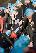 Competitors enter the water for the start of the Soveriegn Harbour Crossing swim. Auckland, 19 November 2006.