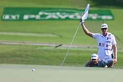 September 20, 2018 - Atlanta, Georgia, United States - Dustin Johnson (L) and his caddie Austin Johnson line up a putt on the 15th green during the first round of the 2018 TOUR Championship. (Credit Image: © Debby Wong/ZUMA Wire)