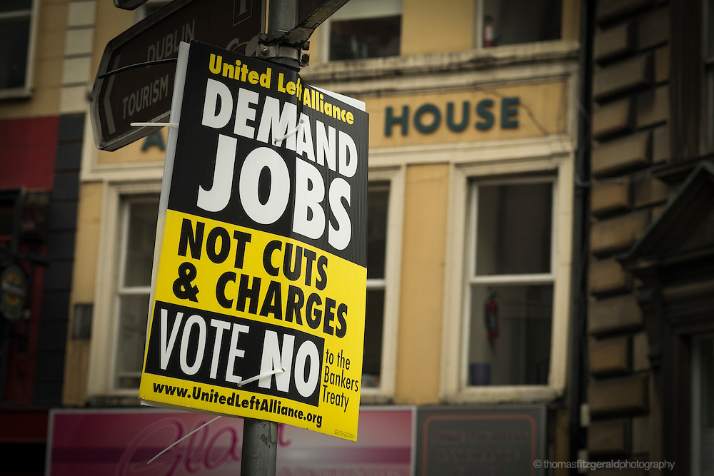 "Dublin, Ireland, 2012: A ""Vote No"" poster from the United Left alliance as seen in Dublin City Centre. The Poster features the slogan ""Demand Jobs, Not Cuts & Charges"""
