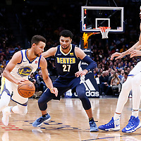 04 November 2017: Golden State Warriors guard Stephen Curry (30) drives past Denver Nuggets guard Jamal Murray (27) on a screen set by Golden State Warriors center JaVale McGee (1) during the Golden State Warriors 127-108 victory over the Denver Nuggets, at the Pepsi Center, Denver, Colorado, USA.
