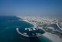 Dubai, one of the seven emirates and the most populous of the United Arab Emirates sits on the southern coast of the Persian gulf. On the right the Jumeirah beach hotel resort.