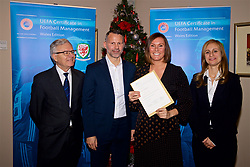 NEWPORT, WALES - Wednesday, December 12, 2018: Caroline Spanton receives her certificate from Wales national team manager Ryan Giggs alongside Jean-Loup Chappelet, UEFA CFM Dean (L) and Valentina Mercolli, UEFA HatTrick Programme Manager (R) during the UEFA Certificate of Football Management Graduation Ceremony in the 2010 Clubhouse at the Celtic Manor Resort. (Pic by David Rawcliffe/Propaganda)