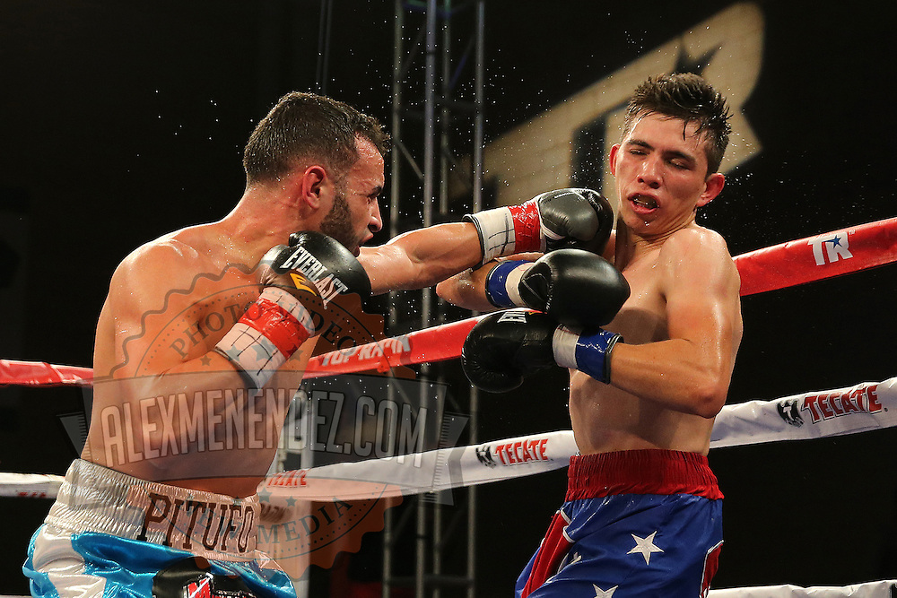 TAMPA, FL - FEBRUARY 28:  Christopher Diaz (L) lands a left jab to the face of Luis Ruiz Jr. during the SoloBoxeo Tecate boxing match at the University of South Florida Sundome on February 28, 2015 in Tampa, Florida. Diaz won the bout by unanimous decision.   (Photo by Alex Menendez/Getty Images) *** Local Caption *** Christopher Diaz; Luis Ruiz Jr.
