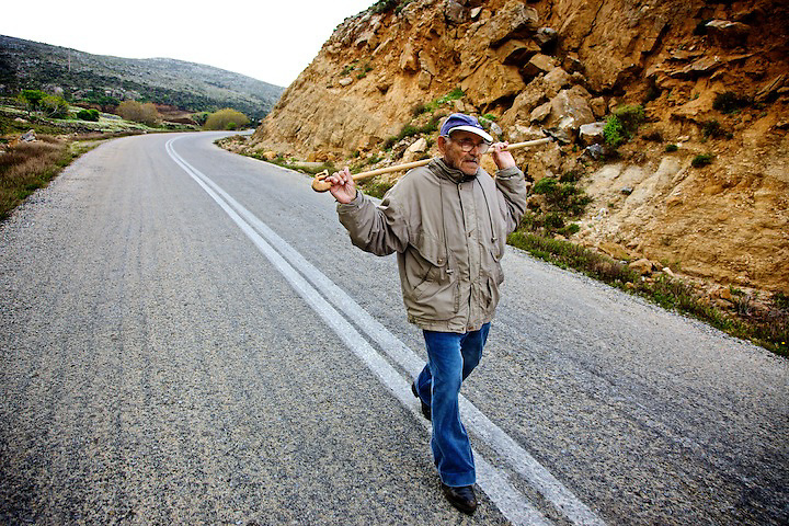 Yannis Tsagas, 99 years old lives in Dafni..Altough his left eye doesn't allow to see very well, his body is still perfectly fit. Everymorning he wakes in the dark and leave his house to walk uphill in to the mountains (about 2,5 - 3 miles), to check on his granson's goats, then he walk back around 7:30 AM, and finally he sits for a coffe. Sometimes he carries with him his shotgun.