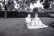 brother and sister posing with toddler 1960s